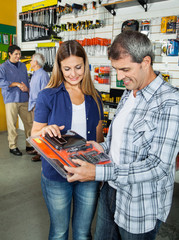 Happy Couple Buying Tool Set In Hardware Store