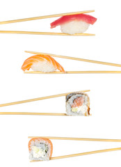 Sushi roll and nigiri in chopsticks isolated on white background