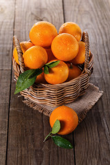 Organic oranges in a woven basket