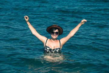 Happy woman enjoying sea