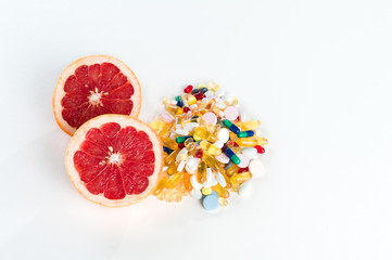 grapefruit and pills, vitamin supplements, healthy diet concept