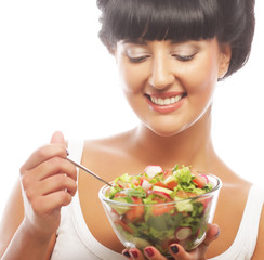 Young funny woman eating salad
