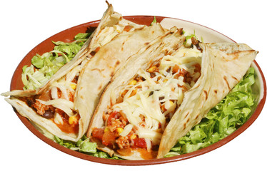 Mexican food served with cheese and green salad in traditional p