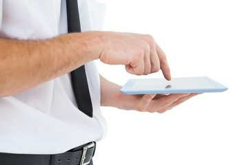 Businessman scrolling on his tablet pc