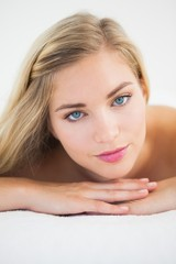 Beautiful blonde lying on massage table looking at camera