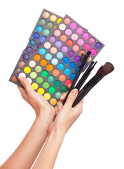Female hand holding a makeup palette, white background