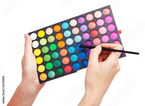 Leinwandbild Motiv Female hand holding a makeup palette, white background