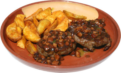 Barbecued Delicious Pork beef steaks with grilled potatoes chips