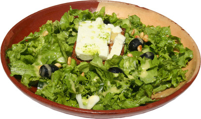 Fresh and tasty green salad with cheese and olives