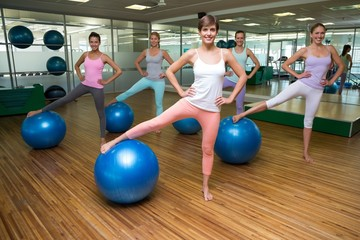Fitness class using exercise balls in studio