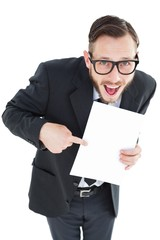 Geeky smiling businessman showing paper
