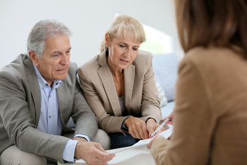 Senior couple meeting real estate agent