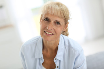 Portrait of smiling senior woman at home