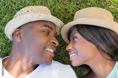 canvas print picture Happy couple lying in garden together