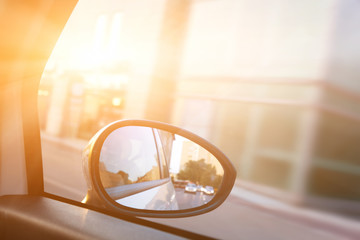 Dynamic view from car on the wing mirror during drive