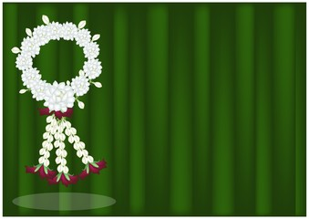 Jasmine Flowers Garland on Banana Leaf Background