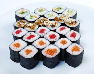 Roll made salmon, eel, tuna, vegetables