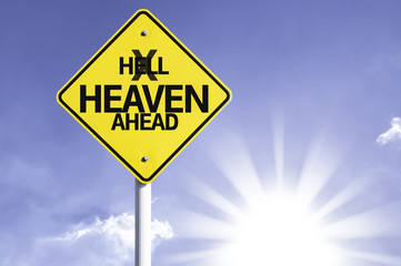 Heaven Ahead road sign with sun background