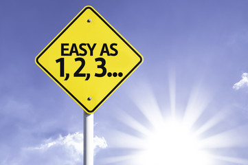 Easy as 1, 2, 3 road sign with sun background