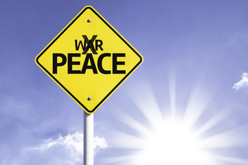 Peace road sign with sun background