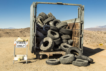 Old tires in a dumpster.