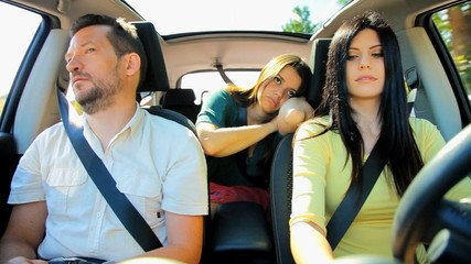 Three friends bored about traffic in car