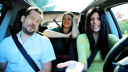 Three friends having fun in car going in vacation