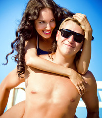 pretty young couple having fun on the beach