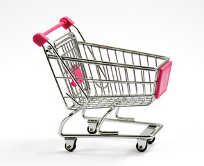 Metal shopping cart or trolley on white