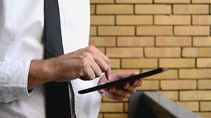 Businessman holding digital tablet computer
