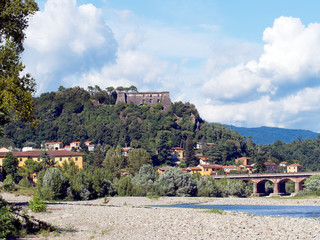 Aulla - view of town from river, with Brunella fortress in bacgr