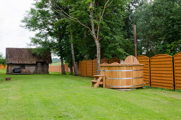 wooden hot tub water rural yard. outdoor pleasure.