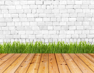 Old wall and green grass on wood floor.