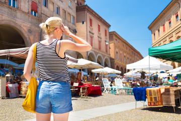 Lady on flea market in Bologna, Italy.