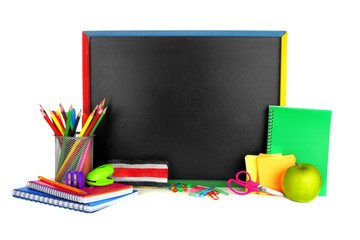Blank blackboard with school supplies surrounding