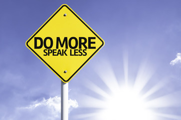 Do More, Speak Less road sign with sun background