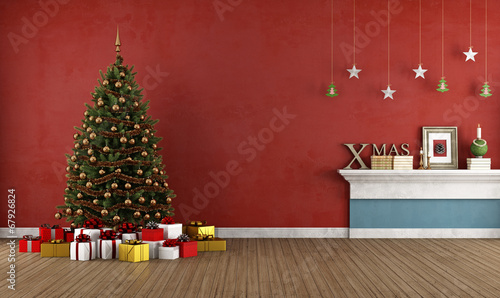 Old red room with christmas tree - 67926824