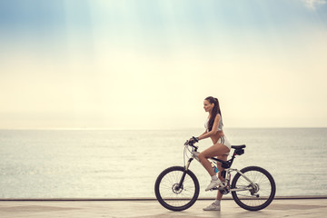 Image of a beautiful girl on the bike