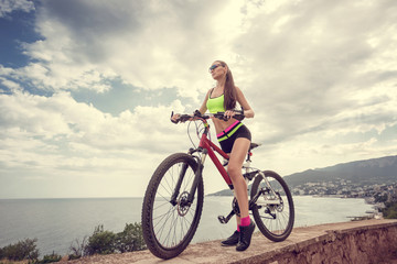 A beautiful girl on the bike