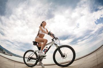 A beautiful girl on the bike
