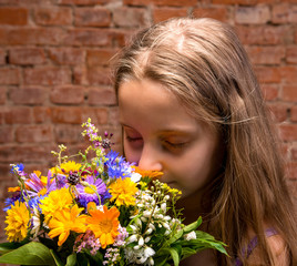 Girl in studio with flowers