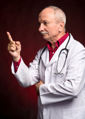 Senior doctor pointing upwards
