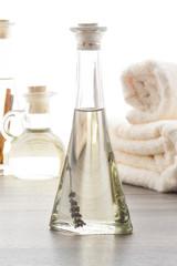 Lavender massage oils with beige towels
