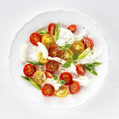 Salad with mozzarella, red and yellow cherry tomatoes