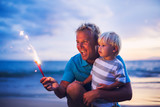 Father and son lighting fireworks - Fine Art prints