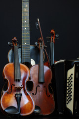 violin guitar and accordion still life