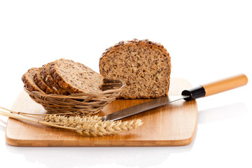 Fresh bread. Slicing Bran Bread on a Cutting Board.