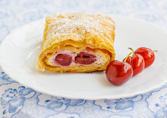 Homemade strudel with cherry and cheese