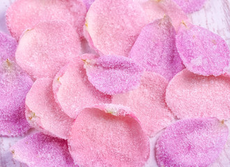 Candied sugared roses petals, background