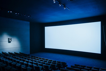 Cinema dark movie theater with blank screen